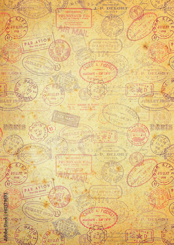 grungy paper background with vintage postage stamps
