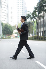 Chinese businessman walking in the city.