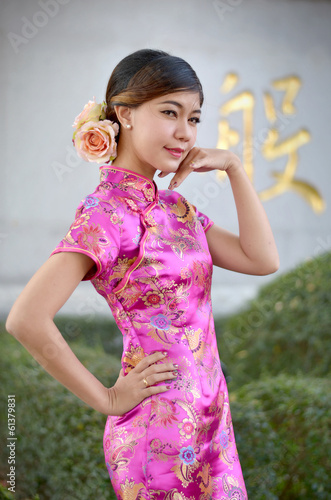 asian woman wearing a cheongsam