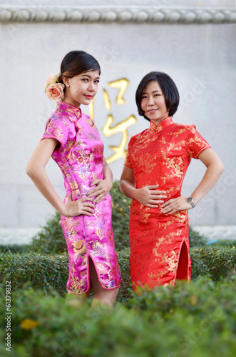two asian woman wearing a cheongsam