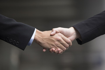 Chinese Business people shaking hands