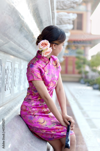 asian woman wearing a cheongsam, chinese costumes
