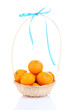 Ripe sweet tangerines in wicker basket, isolated on white