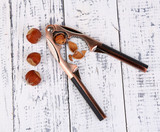 Nutcracker and hazelnuts on wooden background