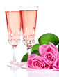 Composition with pink sparkle wine in glasses and pink roses