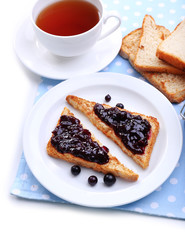 Delicious toast with jam on plate close-up