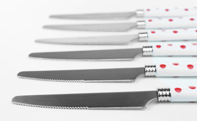 Silver knives isolated on white