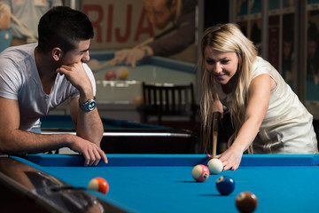 Boy And Girl Flirting On A Pool Game