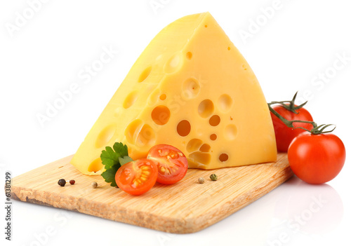 Piece of cheese and tomatoes, on wooden board, isolated on