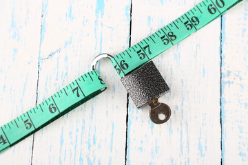 Conceptual photo of unlocking  secret of weight loss. On color
