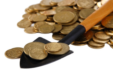 Coins with shovel isolated on white
