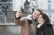 romantic couple in the city taking a selfie