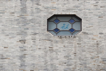 traditional Chinese window and brick wall