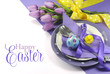 Happy Easter yellow and purple table setting with greeting - 61383427