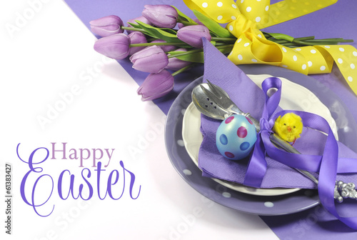 Happy Easter yellow and purple table setting with greeting