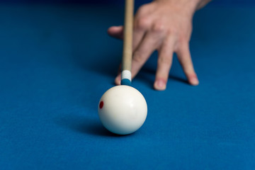 Man Playing Pool About to Hit Ball