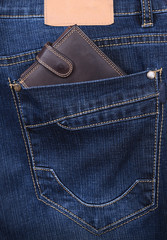 Brown wallet in the jeans back pocket