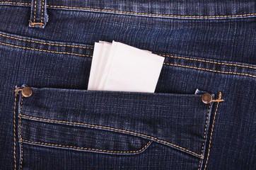 Paper handkerchief in the back jeans pocket