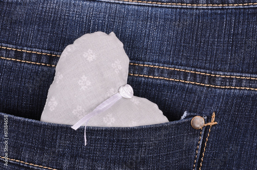 Gray heart shape in jeans back pocket
