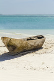 Isolated wooden canoe on the beach in Zanzibar (Kendwa)