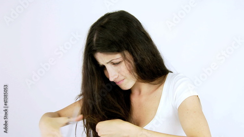 Happy woman cutting split ends damaged hair