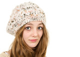 Happy young teen girl posing in a woolly hat