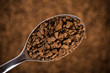 Spoon of coffee at coffee background