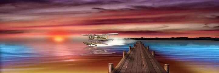 Wasserflugzeug landet in der Abenddämmerung