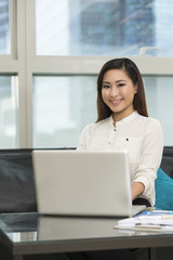 Young Asian business woman working from home.