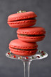 Three pink macaroons on a glass stem