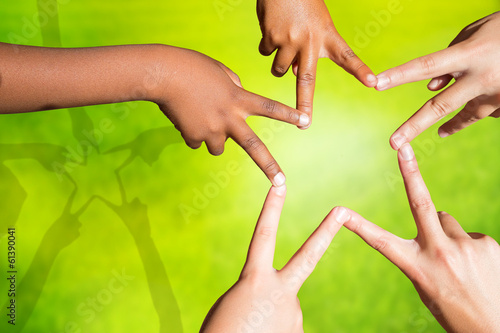 Kids joining fingers forming a star.