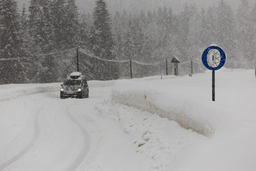 Winter country road covered in fresh snow