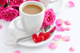 Cup of coffee and roses for Valentine's Day, isolated on white