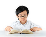 Young Asian schoolboy with glasses reading book
