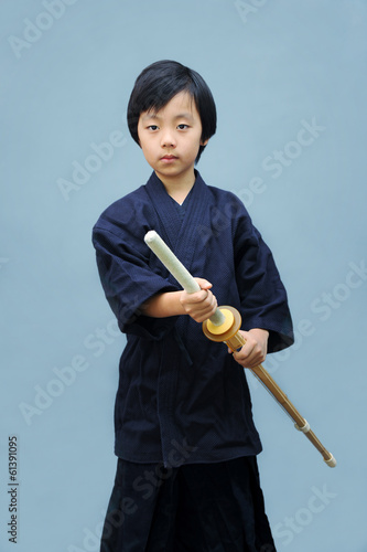 Young Asian boy practicing kendo ( Asian form of martial arts )