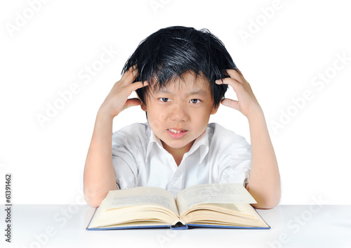 Asian boy getting headache from doing homework