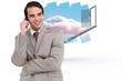 Composite image of smiling salesman on his cellphone