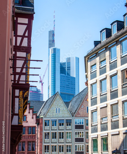 Contrast of old buildings and a skyscraper in Frankfurt, Germany