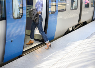 Woman enters train