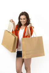 Portrait of a happy Asian woman with shopping bags.