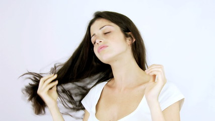 Woman with split ends hair cutting it