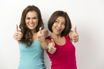 Two Asian Women with both thumbs up