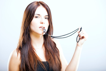 Athletic fitness trainer woman with whistle