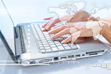 Hands of woman typing on the laptop