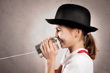 girl using a can as telephone