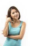 Portrait of a happy Asian woman making call me gesture