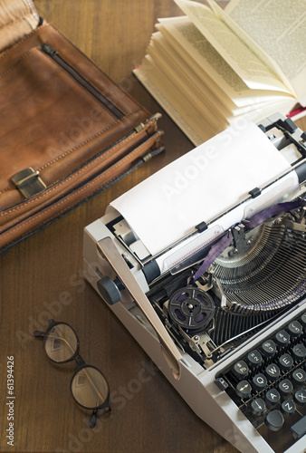 Typewriter and briefcases