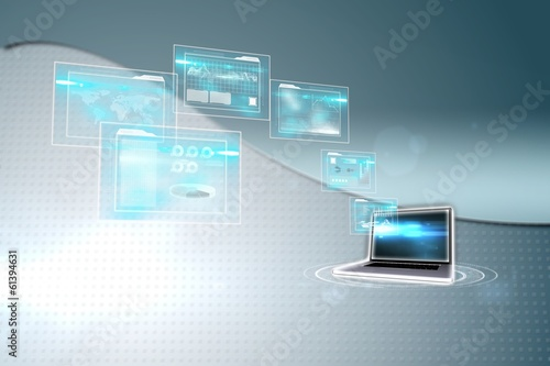 Composite image of business interfaces and laptop