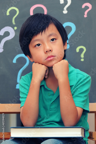 Young Asian boy thinking