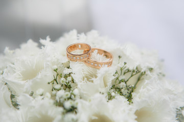 Wedding rings on a white tulips flowers